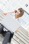 Beautiful Businesswoman On A Break With Laptop And Phone