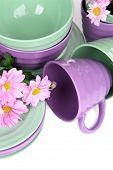 Bright dishes with flowers close up
