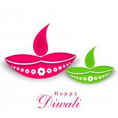 Happy Diwali celebration with illuminated oil lit lamps and stylish text of Happy Diwali on white.