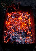 image of ember  - Bright sparkling embers in a brazier as background - JPG