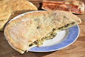 stock photo of escarole  - stuffed pizza with escarole and pine nut