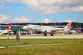 ZURICH - September 21: Embraer of Niki taking off at Zurich Airport on September 21, 2014 in Zurich,