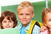 Children near each other in front of blackboard