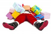 image of christmas claus  - santa claus too tired to lie on floor with many gift boxes over white background - JPG