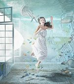 stock photo of flood-lights  - the young beautiful girl underwater in the flooded interior - JPG