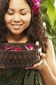 Pacific Islander woman holding spa treatment bowl