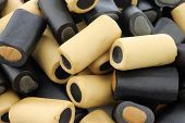 background of brown and black liquorice