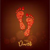 Hindu mythological Goddess Laxmi's footprint with stylish text of Diwali for Diwali celebration.