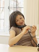 Asian businesswoman talking on telephone