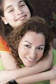 Hispanic girl hugging mother