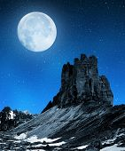 Tre cime di Lavaredo in night sky with moon , Dolomite Alps, Italy