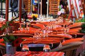 empty, orange restaurant tables