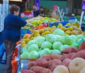 People On An Isral Outdoor Fruit And Vegetable Market