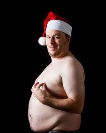 stock photo of nipples  - Fat man Wearing a santa hat grabbing in nipple - JPG