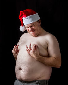 foto of nipples  - Man pinching his nipples very hard and looks to be in pain - JPG