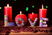 Romantic gift with candles on lights background, love concept