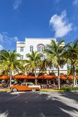 The Art Deco Edison Hotel And A Classic Oldsmobile Car
