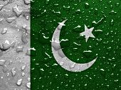 stock photo of pakistani flag  - a flag of Pakistan with rain drops - JPG