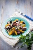 octopus salad with sliced orange