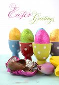Happy Easter Chocolate Eggs Wrapped In Bright Color Foil In Red, Yellow, Blue, Green And Purple Polk