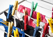 Mixed  Clean Laundry Pinned With Colourful Clothespins