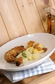 Grilled Organic Drumsticks With Potato On A Plate