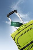 Monte Carlo, Monaco. Green Suitcase With Label