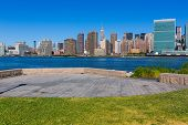 Manhattan New York sunny skyline East River NYC garden park turf USA