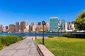 Manhattan New York sunny skyline from green park turf East River NYC USA
