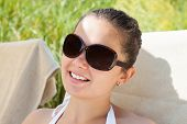 Woman Wearing Sunglasses On Sunny Day At Resort