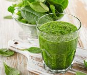 Spinach Smoothie In A Glass On  Wooden Background