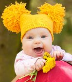 Happy Baby With Bouquet Of Dandelions