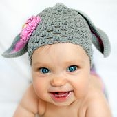foto of spring lambs  - Happy baby in the hat like a bunny or lamb - JPG