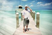A man on the wooden jetty. Great Exuma, Bahamas