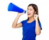 Woman yells to megaphone
