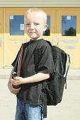 image of playground school  - A boy on the playground of his school with a backpak - JPG