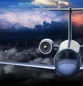 Passenger aeroliner flies through the storm.