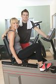 Young athletic couple in gym on training