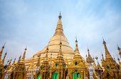 stock photo of yangon  - Shwedagon Pagoda Temple shining in the beautiful sunset in Yangon Myanmar - JPG
