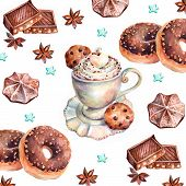 White cup of cappuccino with chocolate, chocolate donuts, marshmallows, chocolate cookies and anise.