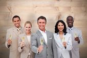 Business team celebrating a success with champagne against bleached wooden planks background