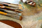 Different brushes on wooden palette