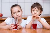 Girl And Boy Drink Juice