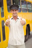 foto of bus driver  - Smiling bus driver looking at camera outside the elementary school - JPG