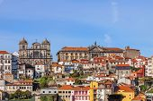 Skyline of the old part of the city of Porto with a view over the Sao Bento da Vitoria Monastery on the left, and the Centro Portugues de Fotografia on the right.