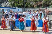 Dancers Demonstrating A Folk Dance At The Beach Of Funchal, Madeira Island