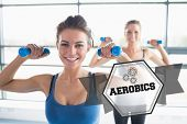 The word aerobics and two women lifting weights against hexagon