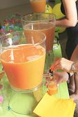 A orange punch with alcohol on it at a party