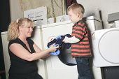 A kid with mother on the dryer having fun
