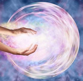 image of outer  - Female hands appearing to break through outer edge into ethereal circular energy formation depicting sending healing energy into embryo - JPG
